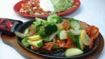 Vegetarian Fajitas - Onions, peppers, tomatoes, zucchini and broccoli served with rice, beans and salad.